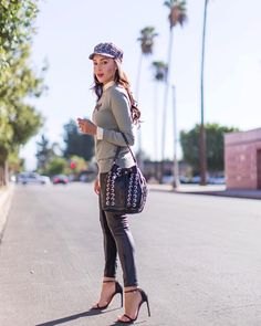 """4,758 Likes, 82 Comments - Elizabeth Keene (@elizabethkeene) on Instagram: """"#ad Casual vibes in leather leggings and a little tweed hat. Loving this hat & sweater that I…"""""""