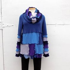 Beautiful, one of a kind and cuddly soft 100 % cashmere recycled sweater. Slate blue, navy blue, baby blue, purple and lavender. Long tunic sweater. Oversized ruffled cowl cashmere collar. So soft, so pretty and so feminine. Long sleeves have snuggly thumb holes. Created from only quality cashmere sweaters. Stitched with coordinating dark blue thread. Long enough to look great with leggings! Bust measures 40 - 46 Back of neck to hem measures 30 From armpit to cuff, sleeves measure 24 4 16…