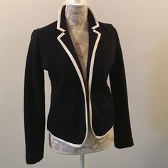 Ponte Lined Blazer Never worn, lined ponte knit blazer with white grosgrain tipping. In perfect condition. Size small. Great with collar up as pic shows... No trades. Old Navy Jackets & Coats Blazers