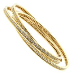 Cartier Diamond Gold Trinity Bangle | From a unique collection of vintage bangles at https://www.1stdibs.com/jewelry/bracelets/bangles/