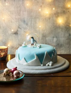 icy snow globe cake recipe. We placed a glass and a plastic penguin on top of the icing to create the globe