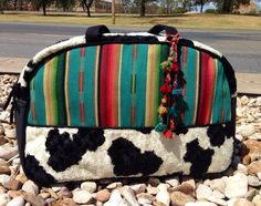 Overnighter Bag, Large enough to fit everything you will need for the weekend! Serape print with a Cow hide accents. This bag is perfect! Yayagurlz