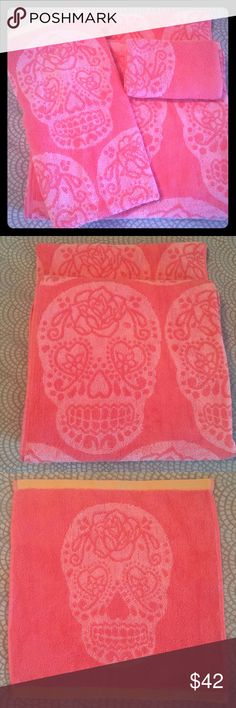 """NWT Betsey Johnson 4 Towels Set Sugar Skull Peach Betsey Johnson 4 Piece SET sugar skull. I would describe color as peach/pink with orange boarder. I also have blue. TWO Bath Towels - 28"""" L x 54"""" W 1 Hand Towel - 26"""" L x 16"""" W 1 Wash Cloth - 13"""" L x 13"""" W Skeleton offers a riskier fashion statement with a slight edge. Plush jacquard is patterned with grinning skulls. The wash size has a single skull. Contrast color end hems add a fashion accent. Bath towel has an embroidered Betsey Johnson…"""