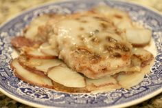 EASY Pork Chop Casserole with layered potato's, pork chops and cream soup on top.