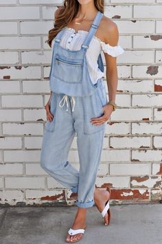 """These light wash tencel overalls feature a drawstring tie waist, zippered front pocket, adjustable straps and side pockets. Light weight and a relaxed fit make these adorable overalls a must-have! 100% Tencel Model is 5'8"""" wearing size Medium"""
