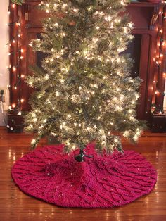 Are you decorating your Christmas tree this weekend? If your tree skirt needs a refresh, you can knit one in a flash with the Cherry Cordial pattern from Berroco yarns. This pretty cabled pattern, … Cable Knitting Patterns, Christmas Knitting Patterns, Free Knitting, Emporio Armani, Christmas Tree Skirts Patterns, Skirt Pattern Free, Skirt Patterns, Cherry Cordial, Knitted Christmas Stockings