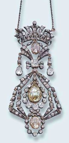 AN ANTIQUE DIAMOND PENDENT NECKLACE  Designed as a central faceted yellow diamond within a diamond collet openwork surround, two suspended briolette diamonds, bow and floral detail and coronet top to the fine-link chain, mounted in silver and gold, circa 1880, pendant 9.0 cm. long, in blue velvet fitted case signed Roesner, Dresden