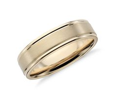 Subtle in detail, this men's wedding ring is crafted in 14k yellow gold with a brushed center band framed by polished edges.