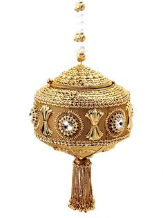 Grandiose golden color #Potli #Purse made of brass metal garlanded with gleaming diamantes and crystals. Item Code: SJBP2019A http://www.bharatplaza.com/new-arrivals/accessories.html