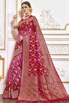 Red And Pink viscose saree with red viscose blouse. Embellished with woven zari work. Saree with U Neck, Half Sleeve. It comes with unstitch blouse, it can be stitched to 32 to 58 sizes. #weddingsaree #weddingwearsaree #festivalwear #partywearsaree