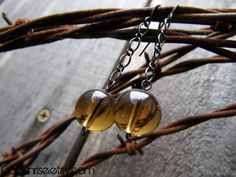 Take a look at our Stunung Glass Collection! Brown Glass & Gun Metal Chain Earrings  Beautiful by CaliSunrise, $6.00