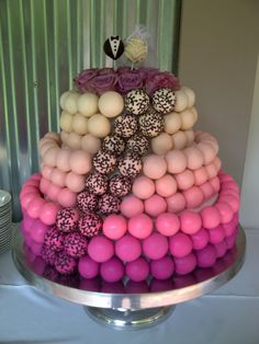 Three tier Wedding Cake Pops with chocolate truffle centres. Pastel shaded balls are layered to the top where the bride and groom are surrounded by roses. Created by Dainty Delights Patisserie Cake Truffles, Cupcakes, Chocolate Treats, Chocolate Truffles, Wedding Cake Pops, Wedding Cakes, Cakepops, Beautiful Cakes, Amazing Cakes