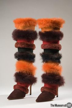 Manolo Blahnik red, orange and burgundy suede and long haired pressed shearling boots 1997 UK. Museum at FIT New York.