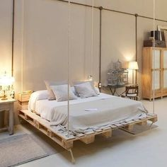 You do not need to buy expensive furniture you just need to have few wooden pellets to make something awesome - chairs bed table pet house shelf multiple storage items and so on. In this article you will find some awesome inspiration ideas! Outdoor Hanging Bed, Hanging Beds, Hanging Chairs, Diy Pallet Bed, Wooden Pallet Furniture, Wooden Pallets, Bed Pallets, Pallet Ideas, Pallet Projects