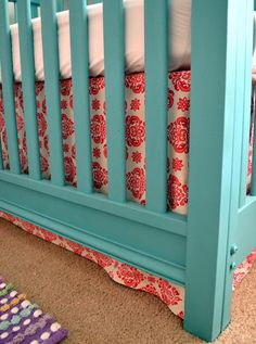 I love red and teal together... This looks great! Don't need a crib... But could use these colors anywhere