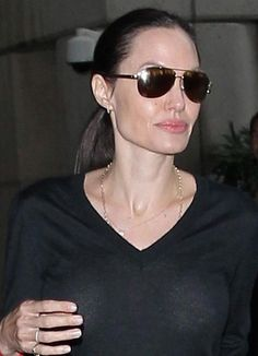 Angelina Jolie looked casually chic in an all black ensemble including black tee, black tapered trouser and black loafers as she left the LAX airport in Los Angeles, on October 27, 2015....