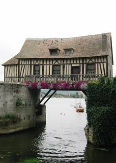 This little bridge house is not far from Giverny, France... Dipped my toes in The Seine River right by this house! Claude Monet came here to paint long ago!