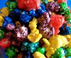 This snack only has 5 ingredients! Easy and fast to make! Think caramel corn, but fruity! Mix and match flavors for tons of neat combinations! My Kids love grape, cherry, and berry blue! You can also make green apple popcorn and drizzle with. Popcorn Snacks, Flavored Popcorn, Snacks Für Party, Popcorn Balls, Gourmet Popcorn, Jello Popcorn, Kool Aid Popcorn Recipe, Popcorn Mix, Colorful Popcorn Recipe