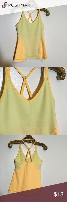 Lululemon 4 EUC Cross Back Tank Yellow Top Bra Adjustable straps & built in light - medium support bra plus removable cups this cross back tank Size 4 is is in excellent condition has been very gently worn & laundered lululemon athletica Tops Tank Tops
