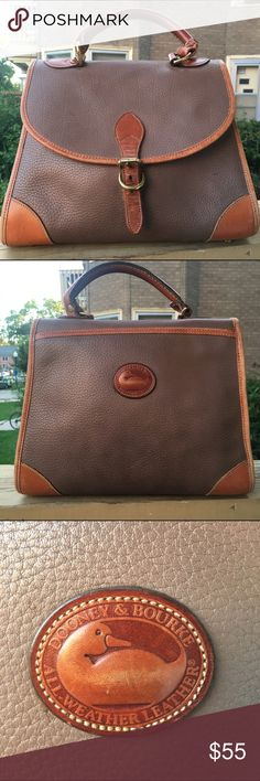 Dooney and Bourke Handbag Vintage Dooney and Bourke pebbled leather handbag with a little discoloration/staining on leather from years of use. Dooney & Bourke Bags