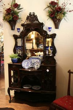 Beautiful antique piece for displaying glassware or collectibles.