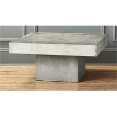 Shop element coffee table.   Industrial chic aggregate of marble, granite, stone and natural fibers cements a sculptural, floating cantilever that reminds us of Wright's Fallingwater.  Clear non-toxic wax finish protects.