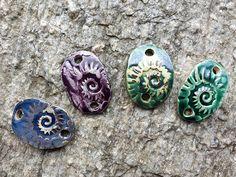 Armbänder für Damen aus Keramik...von KreativesbyPetra        #keramik #ceramic #ton #töpfern #töpferei #plattentechnik #Glasur #glaze #glasurbrand #glazebrand #botz #schmuck #jewellery #Anhänger #pendant #schmuckanhänger #jewelrypendant  #keramikanhänger #Unikat #handmade #handgemacht #Kunsthandwerk #Handwerk #DIY #geschenk #present #Meer #ocean #mädchen #mädels #girls #Damen #woman #textilband #schmuckband #jerseyband #jewelrybelt #geschenk #schnecke #slug #Struktur Gemstone Rings, Gemstones, Detail, Jewelry, Girls, Arts And Crafts, Canvas, Gifts, Snail