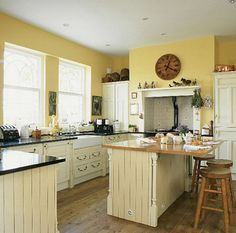 cream glazed cabinets, buttery yellow walls, just need to make the island red :)