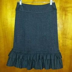 Gray double ruffle hem skirt Great gray skirt with double ruffle hemline and hidden back zip by Lapis. Size small. Waist measures 29 inches. Length 24 inches. The double rufffle hem adds a nice weight to the skirt so that is wears beautifully. Excellent condition. Lapis Skirts