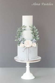 We love this soft pale blue and green wedding cake.