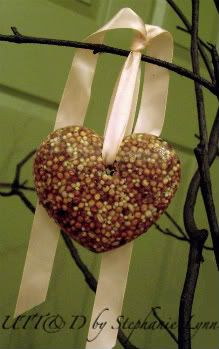 Valentines for the backyard birdies! I have one of the small trees out on my table just a-waiting for bird treats. How perfect to tie in V-day now. I have never seen this done with clear gelatin...I think it just might be a good thing! ~bzb