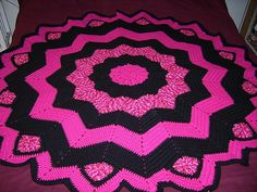 Free crochet pattern on ravelry- It says it's a blanket but with heavier yarn it would make a cute rug!