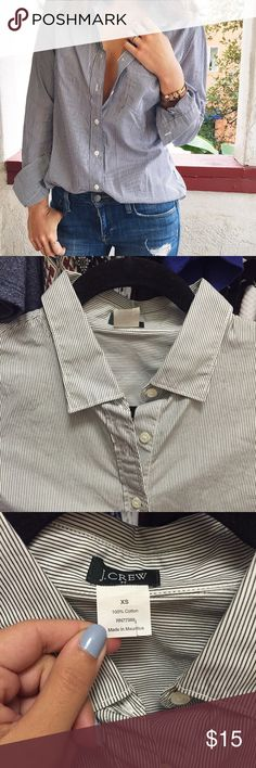 J. Crew Striped Button Down Shirt Only worn once, this shirt is in perfect condition and is a great workwear staple. 100% cotton from J Crew factory, size XS, and I believe it's the Perfect Shirt (but not totally sure). Color most true in last 3 pics - it's like a subtle gray-white stripe J. Crew Tops Button Down Shirts