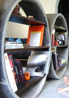 Unique Concrete Bookshelves Act as Room Dividers