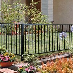 This Home Depot guide discusses fence material types, styles and usage guidelines. Read on for an excellent comparison of the types of fences for your fencing project. Backyard Fences, Backyard Landscaping, Fence Design, Garden Design, Metal Garden Fencing, Metal Fences, Front Yard Fence, Cat Fence, Aluminum Fence