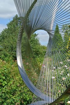 Stainless steel & oak Abstract Contemporary or Modern Outdoor Outside Exterior Garden / Yard Sculptures Statues statuary sculpture by artist Thomas Joynes titled: 'String Theory (abstract Contemporary stainless Steel garden statue)'