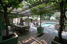 Grote sfeervolle veranda in Franse moderne karakteristieke tuin