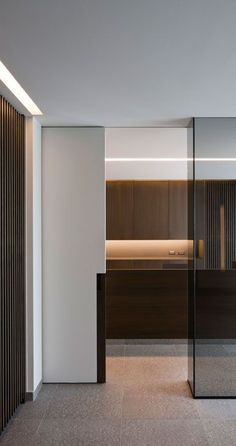 | DETAILS | interieurarchitect Frederic Kielemoes. lovely details using cove lighting, recessed flush sliding hardware for full height doors ... a great example of precise execution in flush detailing #details #kitcheninteriordesigncolor