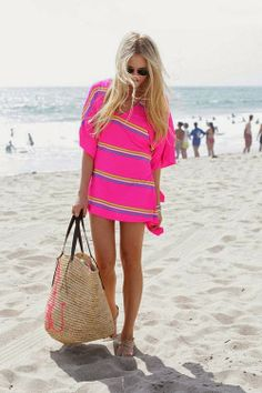 Lovely pink beach stripes cute mini dress with light brown wood type hand bag and cute ladies pumps the perfect summer beach outfits
