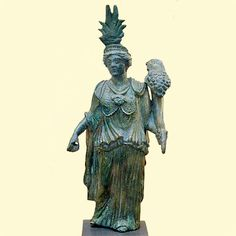 bronze statuette of goddess with syncretic religious symbolism:  attributes of Isis, Minerva, and Fortuna; Roman, second century CE (said to be from Cyprus)