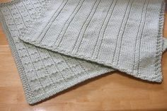 Simple Lines Baby Blankets | The simple details of this knit baby blanket pattern really make it shine.