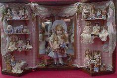 Antique dolls in display case