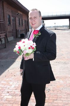 The Bride's brother- holding her flowers.