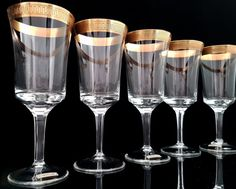 Rare mid Century crystal champagne glasses with a gold rim manufactured by ICHENDORF in West Germany. Very high quality lead crystal, hard gold-plated.  This is a classical series from 1950-60s. Typically for this period, it combines elegance with function. Each glass is decorated with rich textured gold rim.  In very good vintage condition - absolutely no damages. Please take a moment to analyze the pictures for more details.  Each glass is 160 mm (6.30) high. Diameter at the top 65 mm…