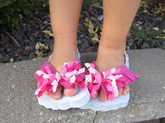 Make Curly Flip Flops......Flip flops from Michaels. Hairbows attached with glue gun!