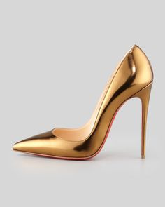 Louboutin gold pumps