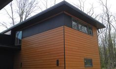 Fiber cement siding cement siding and wood siding on for Stained fiber cement siding