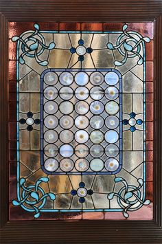 "Large 1880's Leaded Glass Window   	  Original 1880's Leaded Glass Window with 39 Roundel & 16 Molded Glass Details.  This window is in Very Good Condition with only one small piece of glass missing from one  of the Roundels (this can be fixed easily by any Stained Glass Professional).  The Large Reeded Frame Accentuates the window Perfectly.  Overall Size: 70.25""high X 53.25""wide,  Glass Size: 56.25""high X 39.25""wide  AA#42275  $2,500"