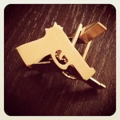 Hand-cut, handgun-shaped cufflinks in sterling silver or gold-plated.