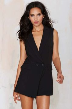 Get suited in this black romper featuring a tuxedo-inspired design, button closures at front, faux pockets at sides, and a hidden zip closure.